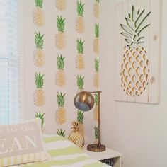 A DIY stenciled accent wall in a guest bedroom using the Pineapple Allover Stencil from Cutting Edge Stencils. http://www.cuttingedgestencils.com/pineapple-fruit-allover-stencil-pattern-design.html
