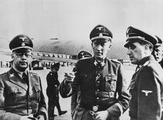 Reinhard Heydrich in Paris, May 1942. On the left - Carl Oberg,  Higher SS and Police Leader (HSSPF) of France, on the right - Helmut Knochen, senior commander of the Sicherheitspolizei (Security Police) and Sicherheitsdienst in Paris.