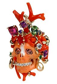 Dior skull ring. Such a perfect pairing: conspicuous consumption + memento mori.
