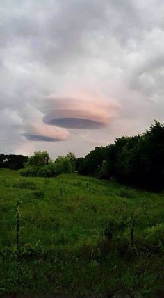LENTICULAR CLOUDS MORE COMMONLY SEEN OVER HILLS AND MOUNTAINS.  SOME PEOPLE SAY THEY LOOK LIKE UFO'S