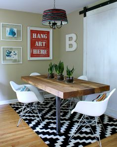 DIY dining space on a budget. Lots of creative ideas including a #yarnbomb light fixture! #diningroom #barndoor #eames