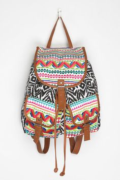 I want this back pack from Urban Outfitters, I LOVE the design    -Ecote Bizarre Backpack