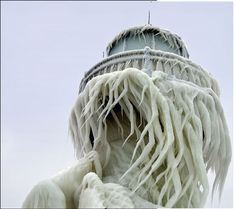 St. Joseph Pierhead Lighthouse in Michigan covered in ice