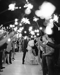 From dramatic fireworks shows to cakes topped with sparklers, see how these real couples threw dazzling weddings. Get inspiration for a grand exit, a first dance, a holiday celebration, and more. New Years Eve Weddings, Real Weddings, Wedding Portraits, Wedding Photos, Cute Couple Poses, Groom And Groomsmen Attire, Bride And Groom Pictures, Countryside Wedding, Wedding Sparklers