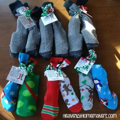 Christmas Sock Gifts http://heavenlyhomemakers.com/fun-christmas-socks-gift-idea-keeping-the-mistle-toes-warm