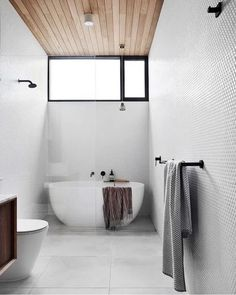 Small bathroom timber cladding Got a small space to work with? Here are our top tips for maximising your bathroom space: Cozy Bathroom, Narrow Bathroom, Bathroom Renos, Large Tile Bathroom, Small Bathroom With Bath, Bathroom Ideas, Parisian Bathroom, Bathroom Canvas, Neutral Bathroom