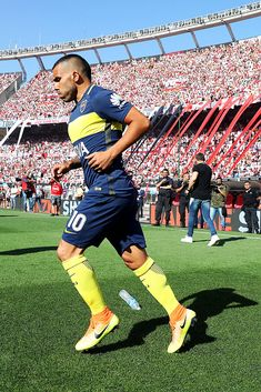 Carlos Tevez of Boca Juniors enters the field ahead of the Argentine Primera Division match between River Plate and Boca Juniors at the Estadio Monumental Antonio Vespucio Liberti on December Get premium, high resolution news photos at Getty Images Messi, Soccer World, Football Wallpaper, December 11, Goku, Tatoos, Celebrities, Sports, Football Shirts