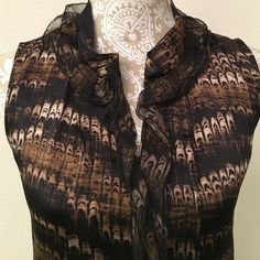 Elie Tahari Silk Blouse This is a black, taupe and olive print Boise from Elie Tahari, size XS. It has pretty sheer tiny ruffles around the nick and front. In excellent condition. Elie Tahari Tops Blouses