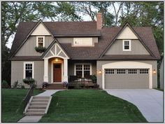 Home Exterior Paint Color Ideas. Home Exterior Paint Color Combinations. Home Exterior Paint Color Schemes. The body of the house is Benjamin Moore Copley Gray. Trim of the house is Benjamin Moore Elephant Tusk Exterior Color Schemes, Exterior Design, Grey Exterior, Stucco Exterior, Craftsman Exterior, Modern Exterior, Exterior Paint Color Combinations, Bungalow Exterior, Colour Schemes