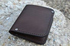 Slim stylish purse. Made of genuine leather harness saddle. Has two compartments for credit cards or business cards, one compartment for small documents