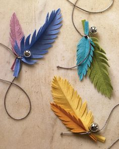 What cat wouldn't love this fun feather toy to play with? Made of wool felt, they're simple to create.