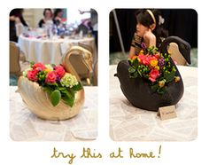 Swan centerpieces - try it at home w/ plastic planters & spray paint.