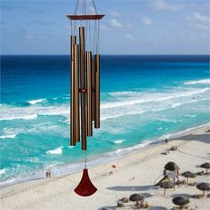 The Wind Chimes of Baja are tuned to the rich tones of the guitarra, the Mexican bass guitar used by Mariachi bands. From the Woodstock Chimes Signature Collection. Deep Tone Wind Chimes, Large Wind Chimes, Wind Sculptures, Amazing Grace, Woodstock, The Locals, Waterfall, Outdoor Decor, Bass