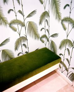 Kate Spade New York - Palm-frond wallpaper and a green bench in a dressing room