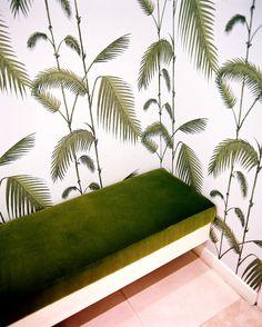 Jewel-toned velvet upholstery + tropical palm-themed wallpaper