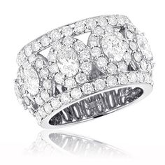 This Unique Diamond Wedding Band is available in 18k white gold, yellow gold, rose gold and can also be custom made in platinum and customized with any color and quality diamonds. Description from itshot.com. I searched for this on bing.com/images