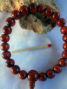 Red Concentric Wood wrist mala.... #naturaltribaldesigns #jewelery #tribaljewelery #shopping #onlineshopping