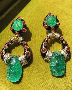 Brand new stunning carved emerald and cabochon ruby earrings with black enamel from @davidwebbjewels.