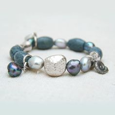 Silver coral bracelet. Blue coral bracelet. Black pearl bracelet. Bohemian bracelet. Boho chic bracelet. Gypsy bracelet. Pulsera con coral.  10% DISCOUNT ON ANY PURCHASE with this coupon code: MINUSTEN  Stylish silver bohemian bracelet with natural blue coral Akori and freshwater pearl. Its assembled on a very strong jewelry elastic band. Any size.  Also you can visit our shop to see more unique jewelry made of natural stones, freshwater pearl and red wood: https://www.etsy.com&#x2F...