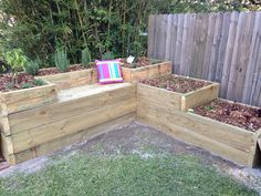 Rasied garden bed. Vegetable and herb garden. Built in seat. DIY sleepers. Bay tree. Flower garden.