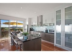 Frosted glass in a kitchen design from an Australian home - Kitchen Photo…