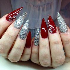 Nails by sarahssnaglar | Silver glitter and dark red stiletto nails.