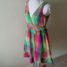 AMERICAN RAG Sundress A wonderful comfy, 100% cotton dress with v-neckline, lower ruffle, back zipper, and self-fabric tie. Size small. American Rag sundress in pink, green, blue, purple, yellow, orange.  Faint red marker mark on front bodice, shown in last picture. American Rag Dresses