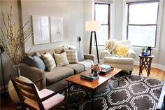 gray walls, tripod floor lamp, west elm rug.
