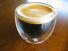 Espresso shot with crema in a vacuum shot glass.