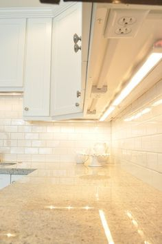 Outlets hidden under cabinets so they don't mess up the backsplash. Brilliant!!