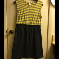 Yellow and gray striped dress Yellow and gray striped dress with black elastic waist and denim-like skirt on the bottom. Small snag, slight pilling on the top portion and small stain as pictured. It might come out, I haven't tried. This is a great dress!! Dresses Midi