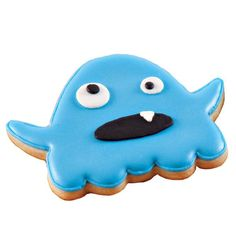Blue Blob Cookie  - Guests and ghouls alike love fun monster cookies! Use the 7-Pc. Monster Cookie Cutter Set, Roll-Out Cookie Dough and bright blue Color Flow Icing to make these great cookies for your Halloween party.