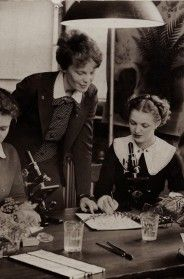 1930s Studying woman with microscopic (with Amelia Earhart in belted polka-dot shirt?)