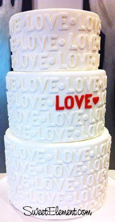 "Modern ""love"" cake but instead of love have your vows written on it ( till death do us part) r I do for rich or for poor etc.."