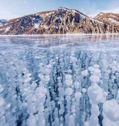 Russian photographer captures stunning images of frozen Lake Baikal, the oldest and deepest lake in the world Lago Baikal, Lake Baikal Russia, Images Of Frozen, Beautiful World, Beautiful Places, Stunningly Beautiful, Seen, Amazing Nature, Belle Photo