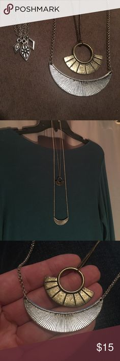 """2 American Eagle necklaces Each work once. 1. Connected gold and silver strand. Gold strand is 18""""-20"""" & silver strand is 28""""-30"""". 2. Connected 3 strand silver necklaces. 14""""-16"""" long. American Eagle Outfitters Jewelry Necklaces"""