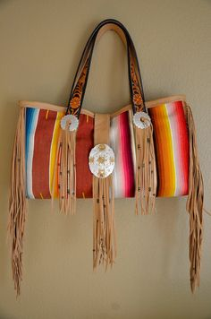 Southwestern tote bag made of vintage Saltillo Serape, hand tooled leather handles, vintage rodeo buckle, and soft cowhide leather by CalicoGold on Etsy https://www.etsy.com/listing/528345724/southwestern-tote-bag-made-of-vintage