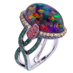 Rare Mexican Fire Opal, Sapphire, Garnet Black Diamonds Ring | From a unique collection of vintage cocktail rings at https://www.1stdibs.com/jewelry/rings/cocktail-rings/