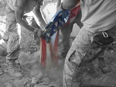 Soldiers from the 2/508 82nd ABN, in the ARV, Afghanistan (2010), pulling the flag out the debris of what was once their compound before getting hit by a VBIED. Where my love was trapped and buried, in the back left of this photo.