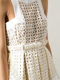 Laser cut dress with tiled pattern & pleated skirt; lasercut fashion details // Alexander McQueen