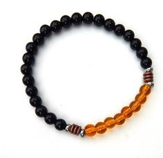 About the Bracelet Our very popular mens black onyx bracelet features golden topaz high quality czech beads for a unique look. Bracelet Details: This mens bracelet is made with: - 6mm Golden Topaz Cze