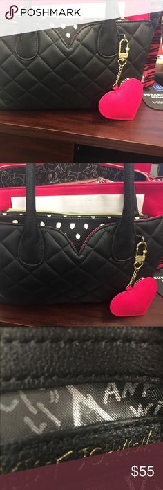Betsy Johnson handbag with small insert bag Beautiful hot pink and black purse with polka dot insert sorry bout all the stuff in it! I haven't switched over yet! This bag can hold so much I have fit a textbook and laptop in it! Betsey Johnson Bags Mini Bags