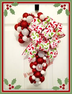 Winter wreath; candy cane wreath; ornament wreath; holiday wreaths; holiday decor; holiday gift ideas; Christmas gift ideas; winter aesthetic; christmas present ideas; Christmas aesthetic; handmade gifts; send a gift ideas; pandemic gift ideas; gift for mom; holiday gifts for neighbors; front door decor ideas; holiday wreaths; winter entryway decor; winter porch decorations; holiday front porch decor; wreath for front door; red and white aesthetic #christmas #giftideas #holidayaesthetic