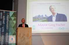 Louisville Mayor Greg Fischer accepting Compassion Week Award for City Leadership