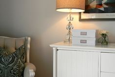 Hide routers, modems and cords in decorative boxes with strategically placed holes.