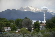 COLORADO SPRINGS, CO - JUNE 8:  A water tower overlooks the community of Security in the foreground of Pike's Peak on June 8, 2016. A invisible toxic chemical has been discovered in the drinking water that affects 70,000 people in the communities south of Colorado Springs. (Photo by Michael Reaves/The Denver Post)