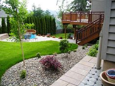 Small Backyard Designs On A Budget 25 easy and cheap backyard seating ideas page 8 of 25 33 Beautiful Flower Beds Adding Bright Centerpieces To Yard Landscaping And Garden Design Backyard Landscaping Ideas On A Budget
