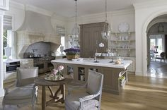 House Tour: Tillingham Estate-Like the layout of this kitchen...across the island a small sitting area with a fireplace-want more modern/commercial kitchen, but possible layout-fireplace with 2 chairs & ottoman and breakfast table with steel window as seen in other pin