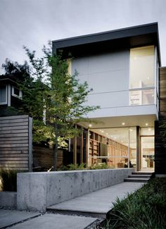 urban infill house, queen anne neighbourhood of Seattle, green roof, solar based hot water system, recyled framing materials into wood siding, combination of rough & clean materials used