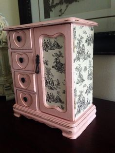 This jewelry box has been hand painted in a pretty pink and lightly distressed. I also decoupaged it in a black and cream Toile. There are
